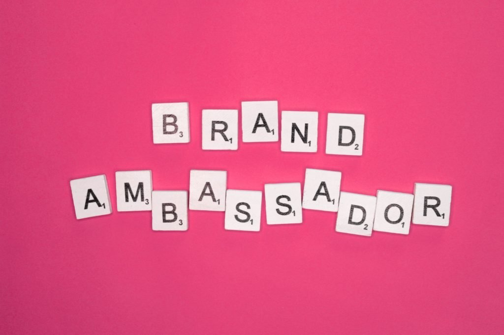Brand ambassador scrabble letters word on a pink background